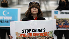 Canadian MPs say China's treatment of...
