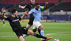 Man City cruise to brink of Champions...