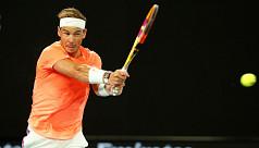Nadal maintains record bid, Djokovic...