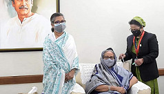 PM Hasina receives her first shot of...